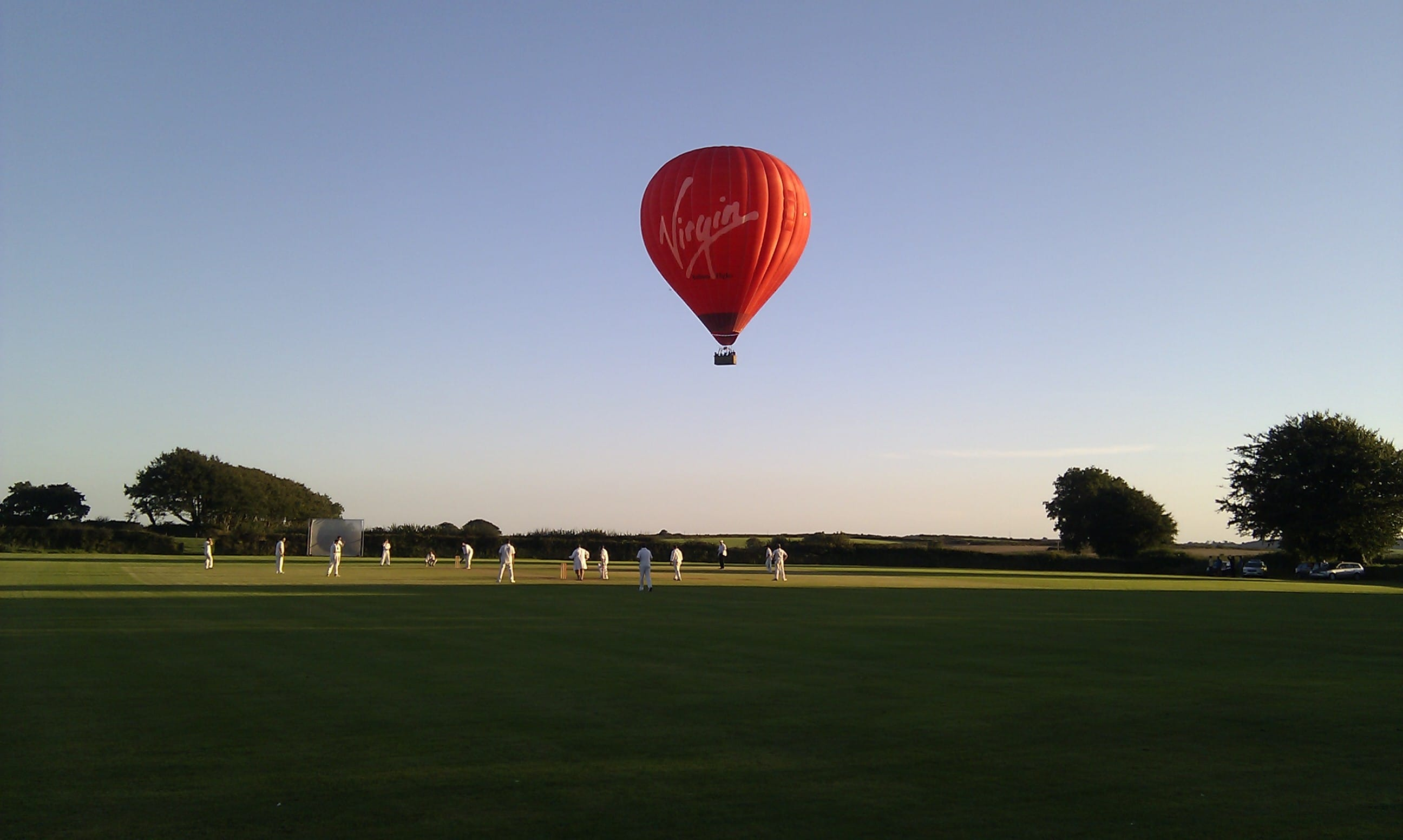 Virgin Hot Air Balloon Over Cornwall Cricket Match By Stephan Rowe