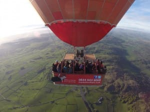 Chris and Rosie (centre of the balloon) and fellow passengers fly high over the Lancashire countryside.