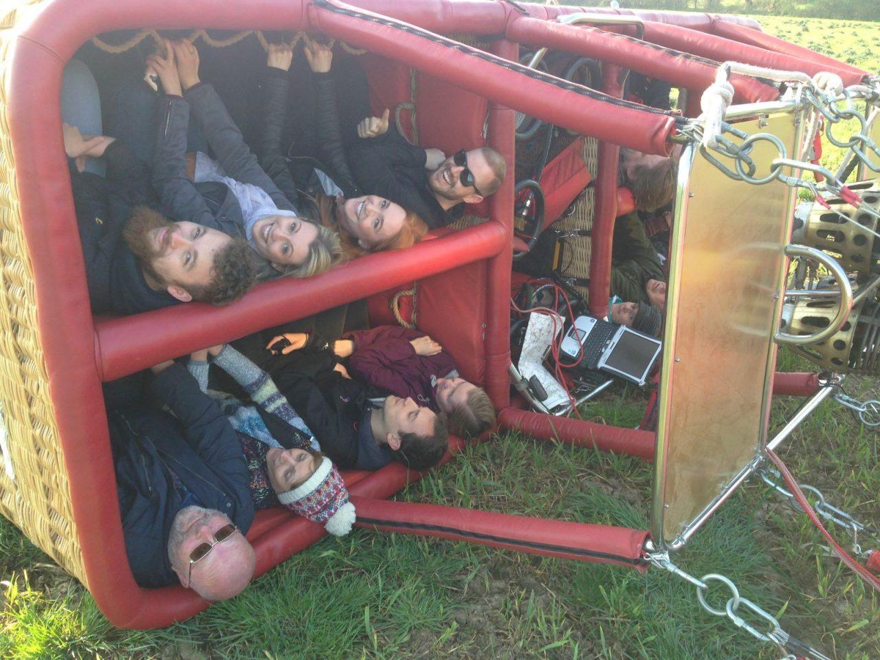 Passengers in a hot air balloon basket drag landing